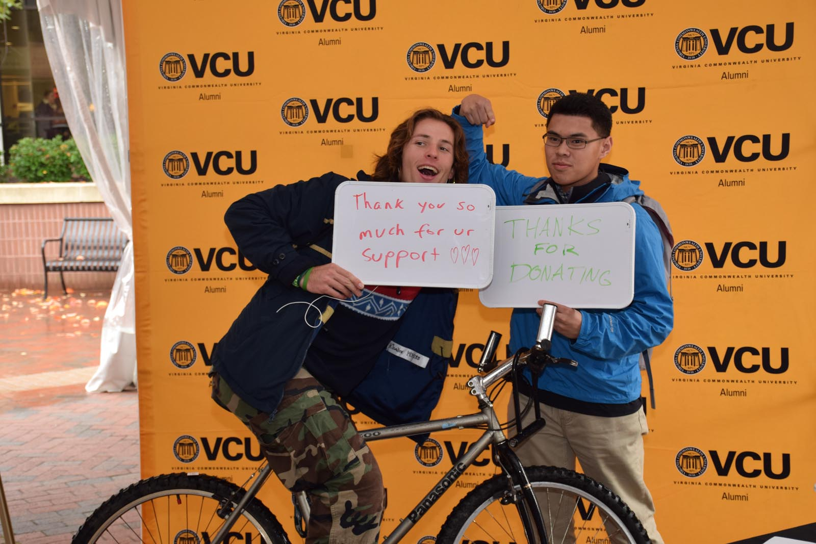 Students with bike and thank you signs