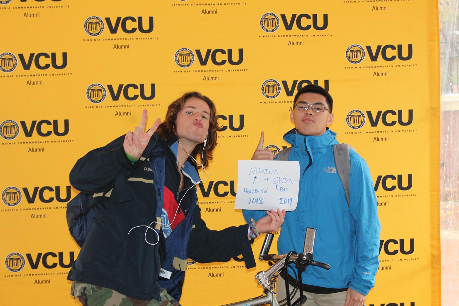Two students with sign