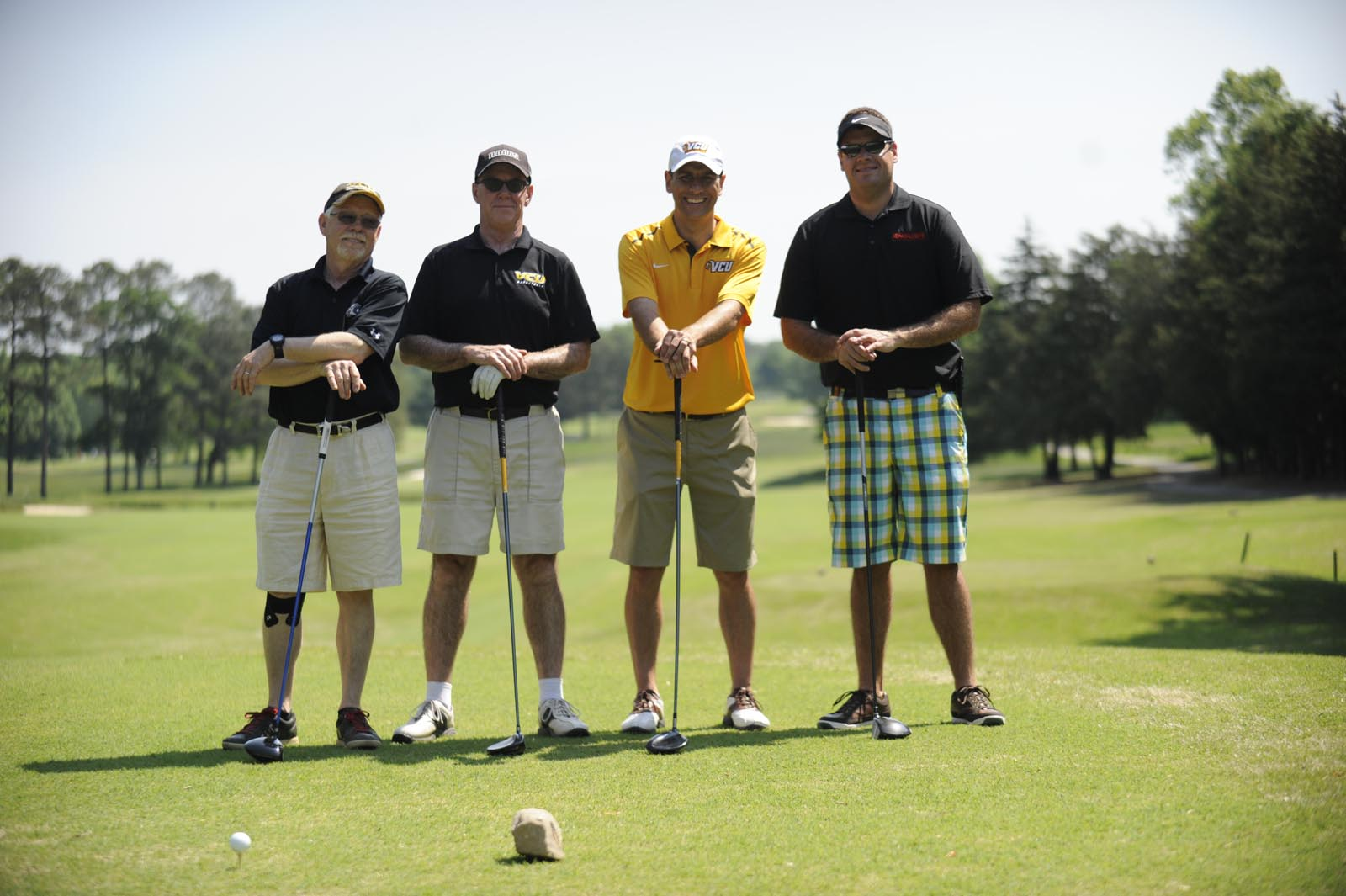 Four playing golf
